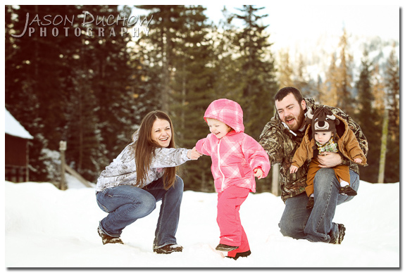 Family photo in the snow by Priest River, Sandpoint, Coeur d'Alene, Newport photographer Jason Duchow