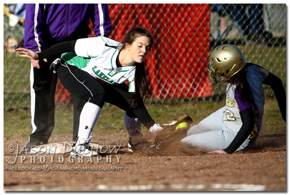 Lakeland's Erin Ogden tags the Kellogg runner out at third