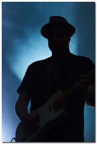 Silhouette of Counting Crows guitar player