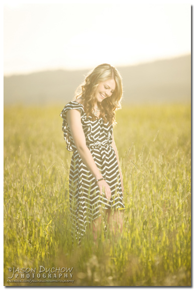 sun bathed senior portrait in a field