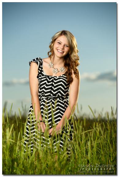 senior portrait in a field