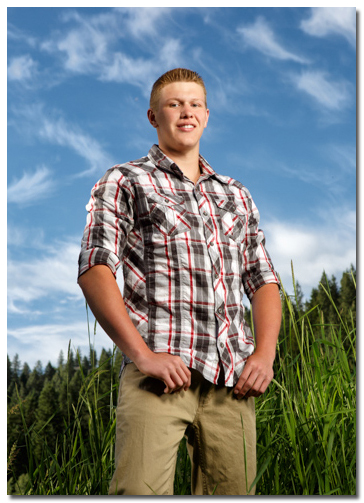 senior photos with blue sky and clouds