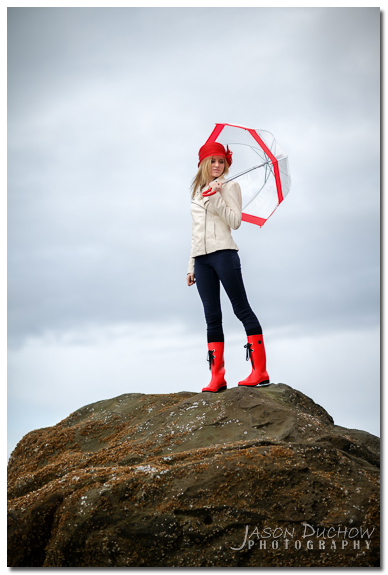 rainy day portrait with a red umbrella and rain boots
