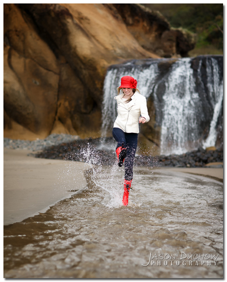stomping in the stream with red rain boots